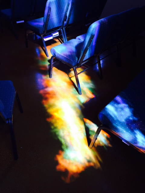 Light Refracted Through A Stained Glass Window Puts